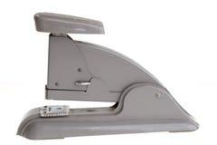 Uitstekende grijze nietmachine, zijaanzicht. Royalty-vrije Stock Afbeeldingen
