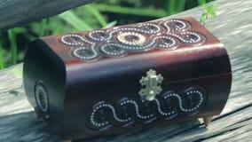 Uitstekende houten borst met koperpatronen stock video