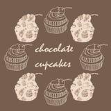 Uitstekende kaart met kader van chocolade cupcakes Stock Afbeelding