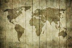 Uitstekende kaart van de wereld over houten achtergrond Royalty-vrije Stock Foto