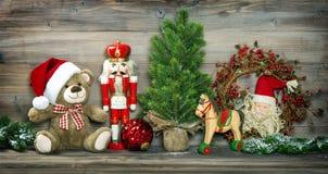 Uitstekende Kerstmisdecoratie Teddy Bear Rocking Horse Nutcracker stock afbeeldingen