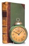 Uitstekende klok en antiek boek Stock Afbeeldingen