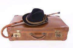 Uitstekende koffer met wandelstok en hoed Stock Foto