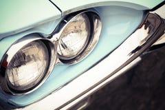 Uitstekende koplamp Stock Foto's
