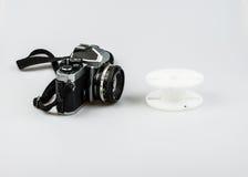 Uitstekende 35mm analoge camera en het ontwikkelen van spiraal Royalty-vrije Stock Afbeeldingen