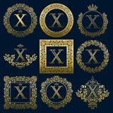 Uitstekende monogrammenreeks van X-brief Gouden heraldische emblemen in kronen, ronde en vierkante kaders stock illustratie