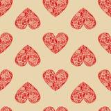 Uitstekende naadloze textuur met rode harten. Stock Foto's