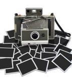 Uitstekende onmiddellijke camera met één of ander kader Stock Afbeelding