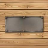 Uitstekende, oude metaalbanner op realistische houten Stock Foto's