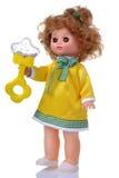 Uitstekende pop in gele kleding met rammelaar Royalty-vrije Stock Foto