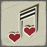 Uitstekende prentbriefkaar met muzikaal teken in de vorm van harten Royalty-vrije Stock Foto's