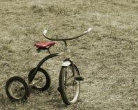 Uitstekende Sepia Driewieler Royalty-vrije Stock Afbeeldingen