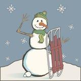 Uitstekende sneeuwman met slee Stock Afbeeldingen