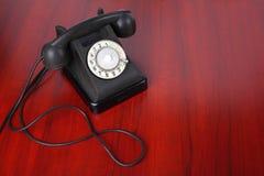 Uitstekende Telefoons - Zwarte een retro telefoon Stock Foto