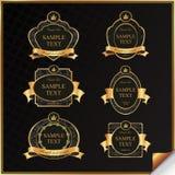 Uitstekende vectorreeks van zwart kaderetiket met goud   Stock Fotografie
