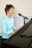 Uitvoerder bij de Piano Royalty-vrije Stock Afbeeldingen