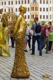 Uitvoerder - goud geschilderde kunstenaars op een stadsstraat, het leven standbeeld Royalty-vrije Stock Fotografie