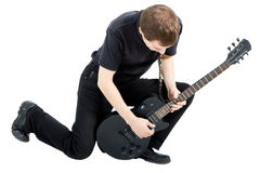 Uitvoerder met een elektrische gitaar Royalty-vrije Stock Foto's