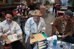 Uitvoerders die in Milan Clown Festival schilderen stock foto's