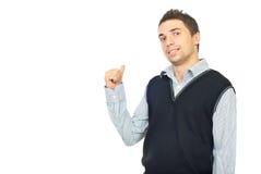 Uitvoerend mannetje dat met zijn duim toont stock fotografie
