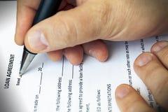 Uitvoering van een leningsovereenkomst stock foto's