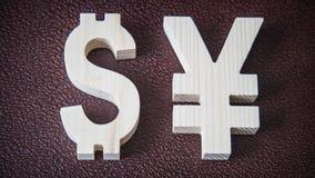 Uitwisselingsclassificatie Dollar, Yen op leerachtergrond Stock Foto's