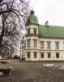 Ujazdowski Castle in late winter. City of Warsaw, Poland. The baroque style of the corner towers of the castle royalty free stock photos