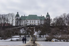 Ujazdowski Castle in late winter. City of Warsaw, Poland. The baroque style of the eastern facade of a high cliff royalty free stock photo