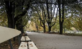 Ujazdowski Park in Warsaw - park alley with benches in autumn royalty free stock photo