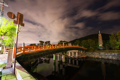 Uji river night scene. Bridge over Uji river and thirteen storied pagoda near with dramatic blurred cloud at night, Kyoto, Japan stock photos