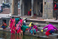 Ujjain, India - December 7, 2017:  People attending religious ceremony on holy river at Ujjain, India, sacred town for Hindu relig Stock Photos