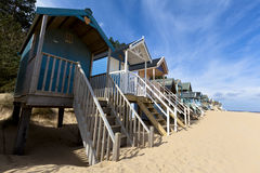 UK Beach huts. Low, wide-angle view of colourful Beach huts Royalty Free Stock Photos