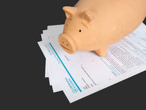 UK blank tax return form with piggy bank money box. Taxation. Stock Image