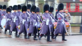 UK. British Royal Guard. UK. Britain. The Royal Guard marching in the street in winter form stock video