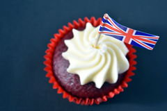 UK celebration cake with british flag. UK celebration cake, party food with red, white and blue cupcake and british flag.  Celebration, patriotism and holidays Royalty Free Stock Image