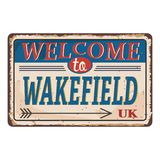 UK cities retro welcome to Wakefield Vintage sign. Travel destinations theme on old rusty background. Vintage sign Travel destinations theme on old rusty stock illustration