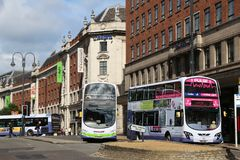 UK city bus. LEEDS, UK - JULY 12, 2016: People ride FirstGroup bus in Leeds, UK. FirstGroup employs 124,000 people Royalty Free Stock Photos