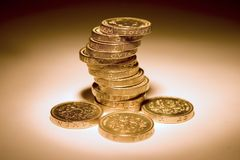 UK Coins. Uk pound coins. The stack of coins is in focus, and the one closest is slightly blurred Royalty Free Stock Photography