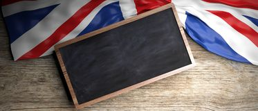 United Kingdom flag placed on wooden background. Blackboard in frame with copyspace. 3d illustration. UK crumpled flag placed on wooden background. Blackboard in Stock Photography