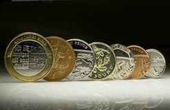 UK Currency coins balanced next to each other. Uk currency coins lined up next to each other royalty free stock photography