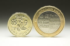UK Currency Coins One Pound and Two Pound Coin Stock Photo