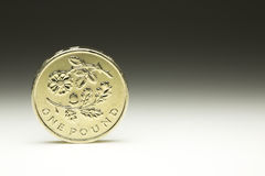 UK Currency One Pound Coin. Balancing UK One Pound Coin Stock Photos