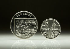 UK Currency Ten and Five Pence coin balancing Stock Photos