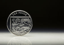 UK Currency Ten Pence Coin balancing Royalty Free Stock Photography