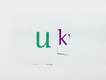 UK - Cutout Words Collage Of Mixed Magazine Letters with White Background. Caption composed with letters torn from magazines with White Background Stock Image