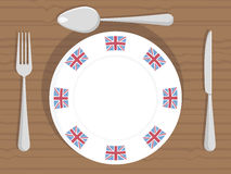 Uk dinner plate. White dinner plate with union jack flag decorations and cutlery Stock Image