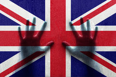 Uk droplet flag with person hands Royalty Free Stock Images