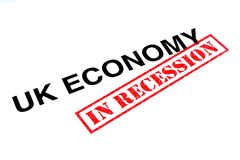 UK Economy In Recession. UK Economy heading stamped with a red IN RECESSION rubber stamp stock photo
