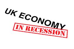 UK Economy In Recession. UK Economy heading stamped with a red IN RECESSION rubber stamp royalty free stock photos