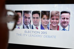 UK Election 2015 TV Debate. A viewer watches election live TV debate on a computer monitor on April 2, 2015 in London, UK. The UK goes to the polls on May 7 in Royalty Free Stock Photos